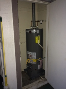 tank type water heater installed in closet space